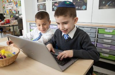 Calderwood Lodge pupils using laptop