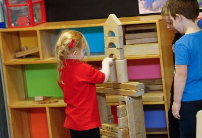 Pupil playing with building blocks