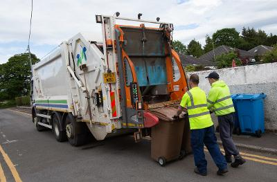 Refuse collectors loading brown bins