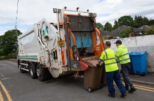 Refuse collectors loading brown bins