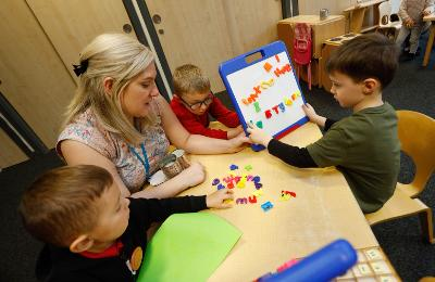 Early years staff teaching pupils
