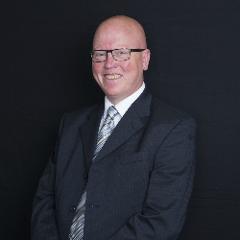 Councillor Colm Merrick